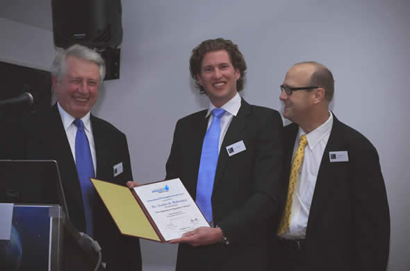 Guido Dolamns receiving the International Dupuytren Award 2012