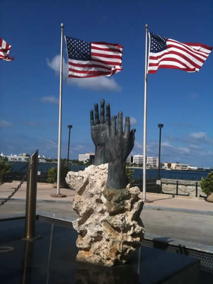 Hands with bent fingers in front of the conference hotel in Miami